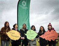 Students plant the first of 1,000 DMU trees in the National Forest