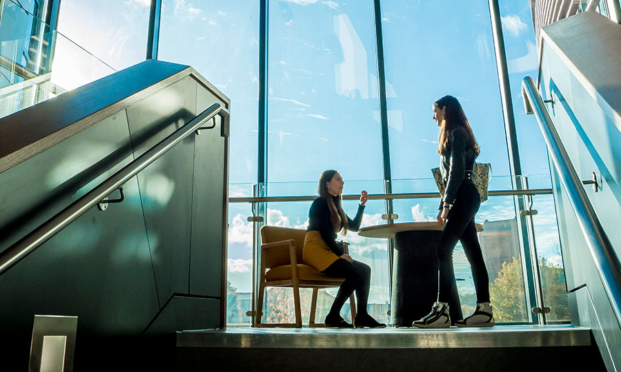 Image of two female students in the Vijay Patel Building