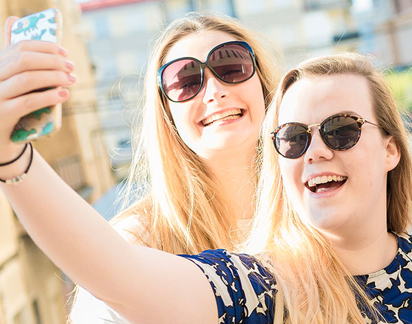 Image of two female students taking a selfie