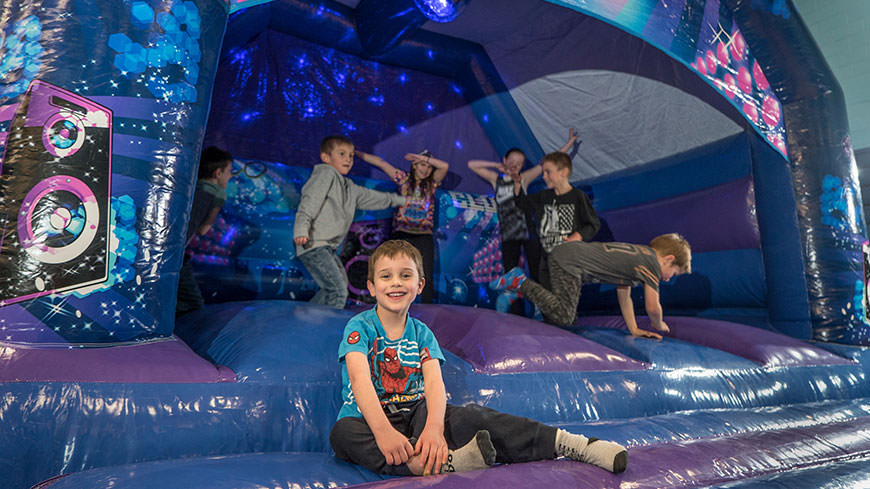 Children at a bouncy castle party at the DMU leisure centre