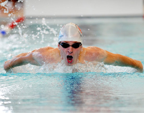 Image of a male swimming in the swimming pool