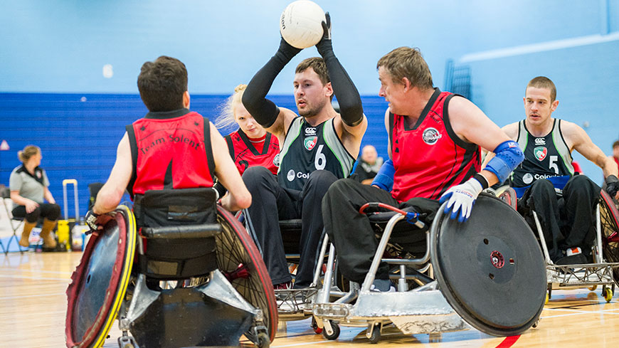 An image of students playing wheelchair basketball