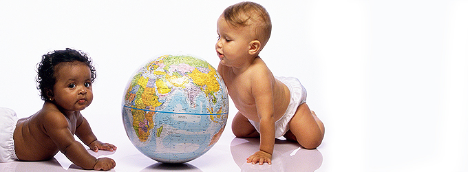 image of two babies playing with globe