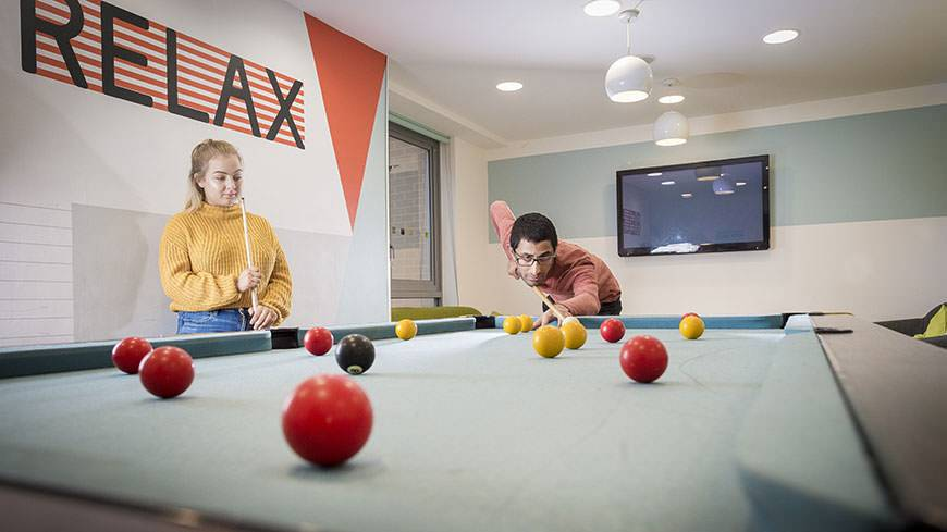DMU students playing pool in their accommodation